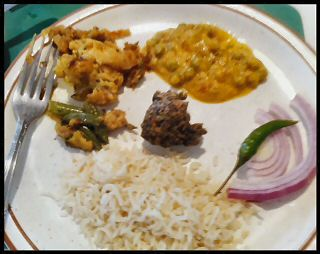 Indian Food - Jeera Rice, Mushroom-Peas Curry, Mixed Vegetable Curry, Spinach Pakora