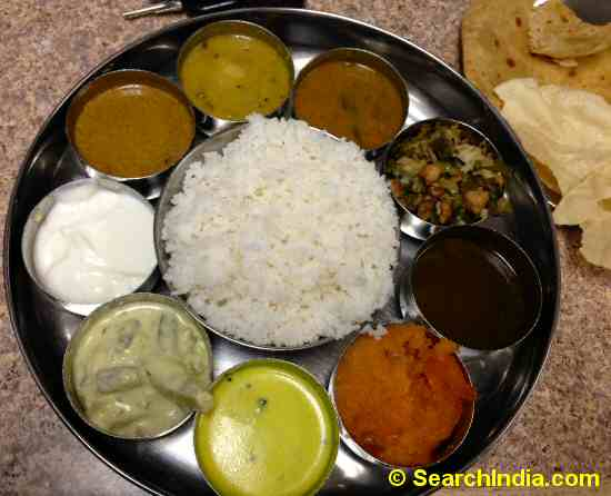 Indian Thali with Curry, Rice, Desserts, Chapati