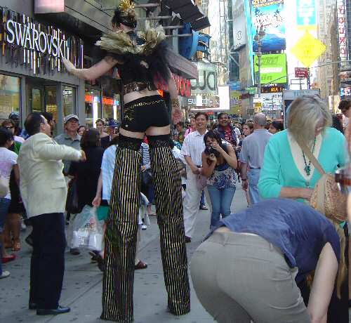 Gal on Stilts in Times Square NYC